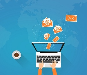 Email Marketing - Person on Laptop Sending Virtual Envelopes